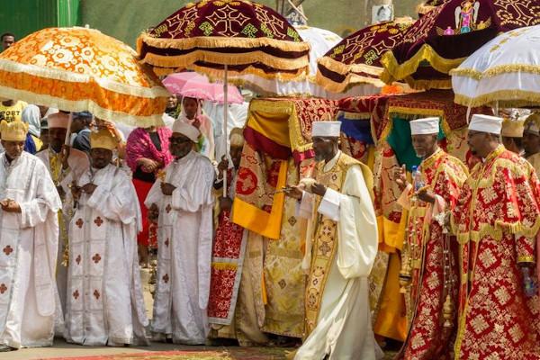 Image - Ethiopian Men Dress & Umbrella